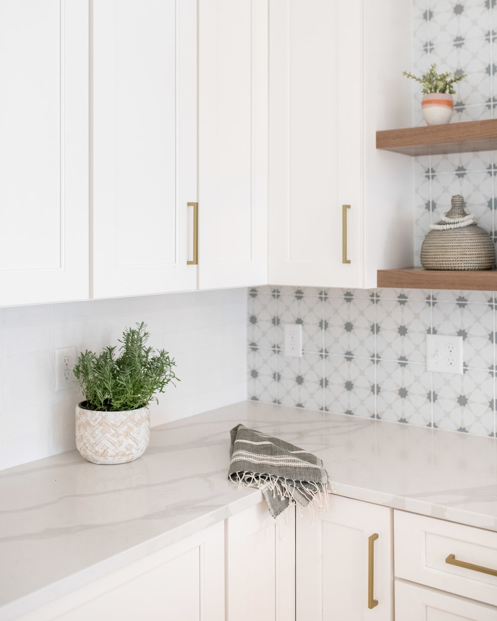 quartz countertops and graphic backsplash