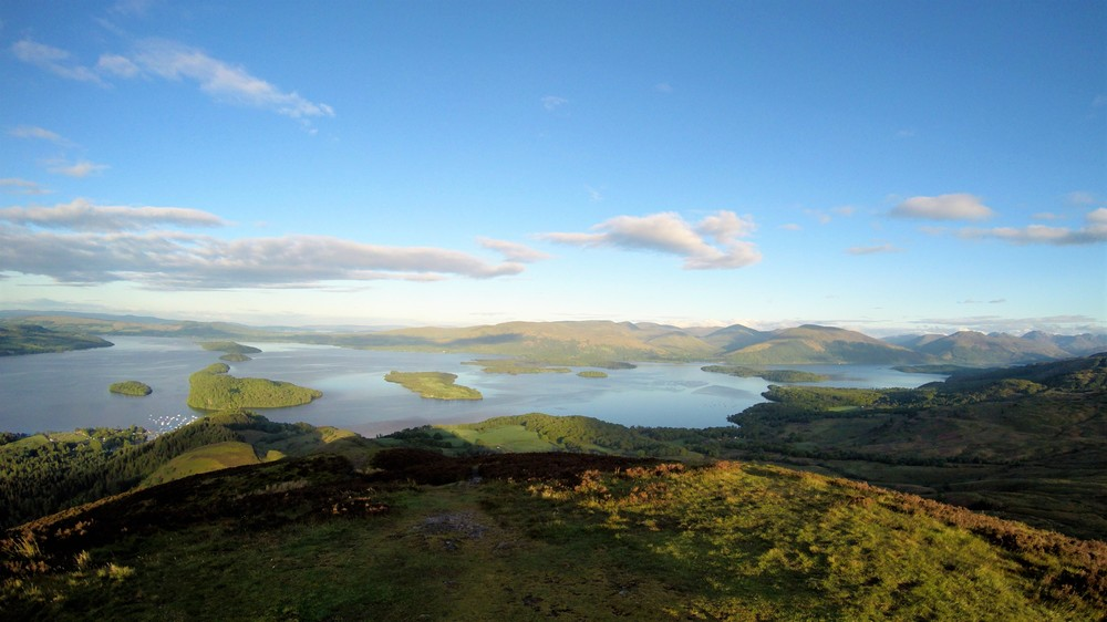 One of the most Iconic scenes from around Loch Lomond, the view from atop of Conic Hill, gazing out along the chain of Island's Inchcailloch, Torrinch, Creinch and Inchmurrin. They all help make up part of the Highland Boundary Fault line, which runs from Stonehaven in the East to the Isle of Arran in the West