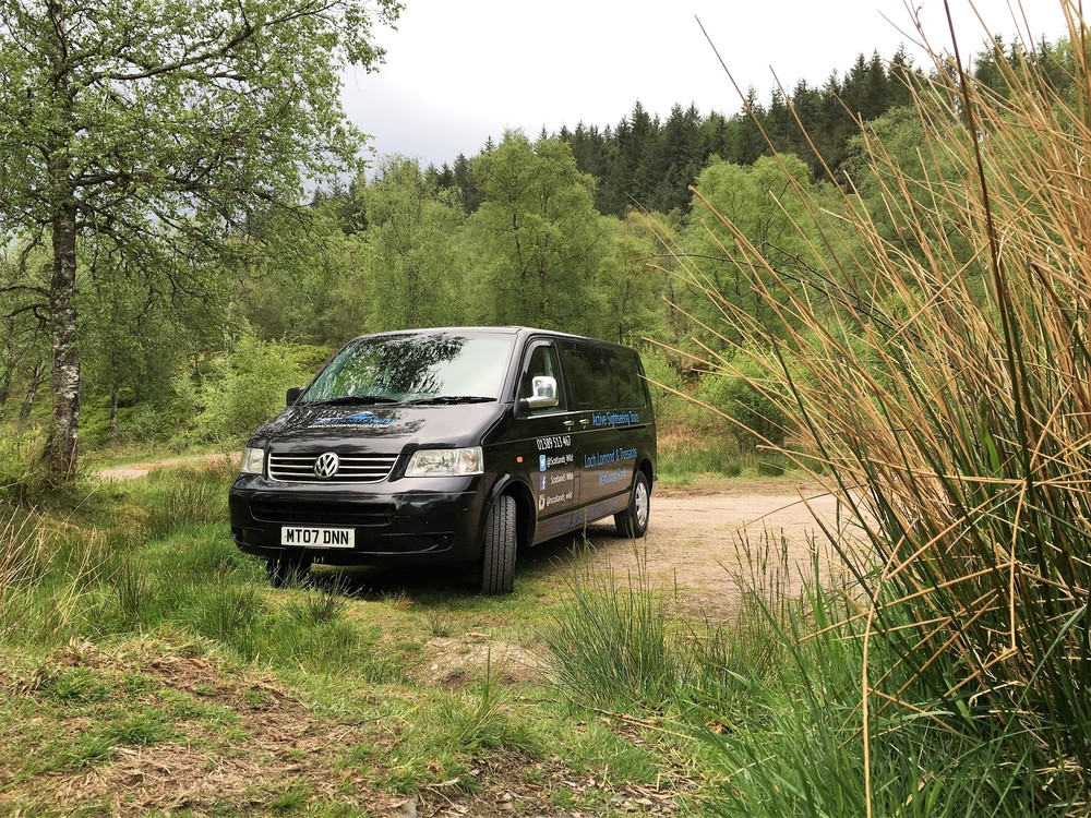 van in a scenic Scottish location