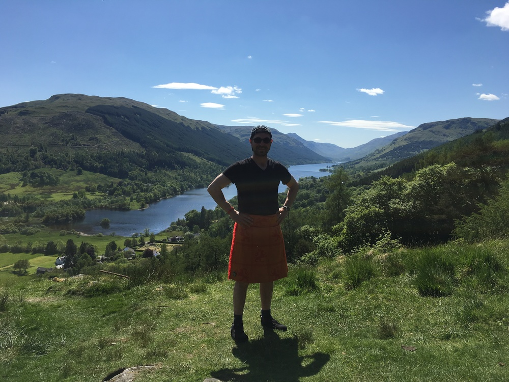 American Visitor in a kilt with Loch Voil and Balquhidder Glen in the background