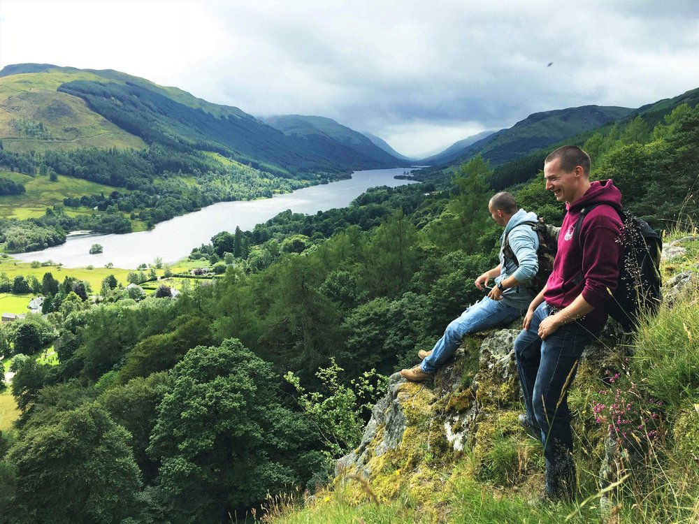 brothers enjoying scenic views down Balquhidder Glen