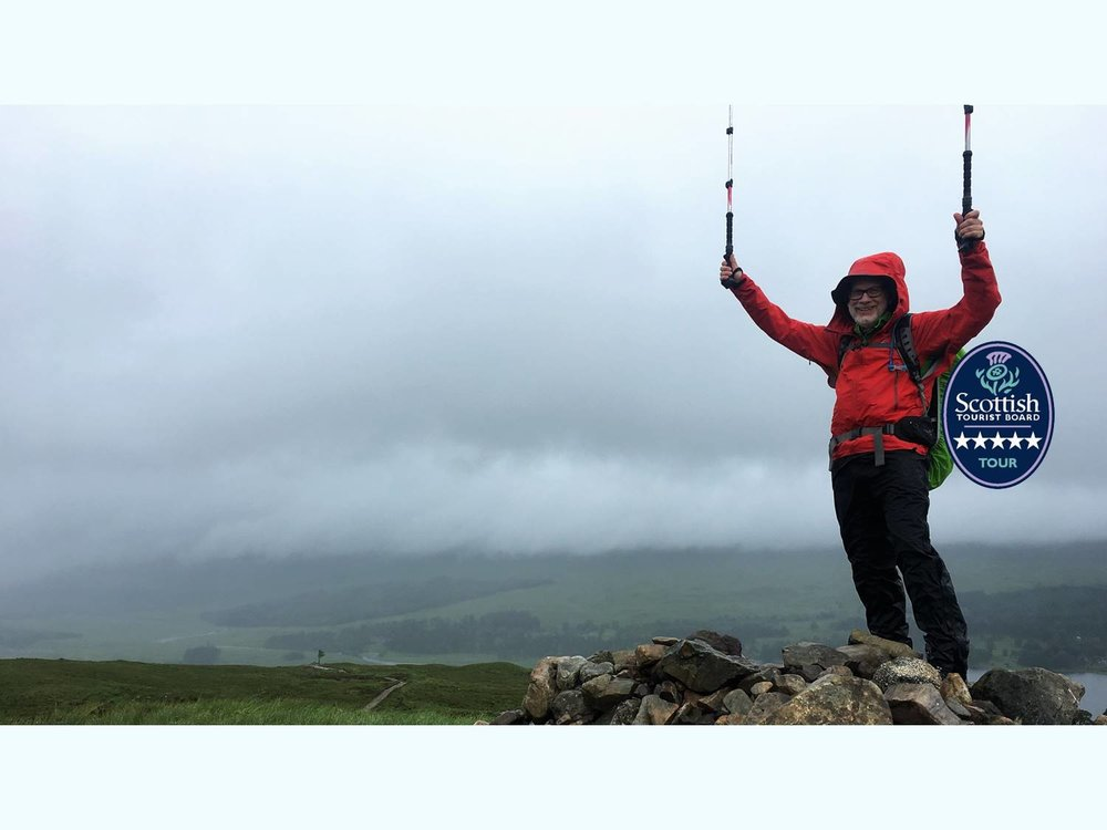 celebrating top of a hill west highland way