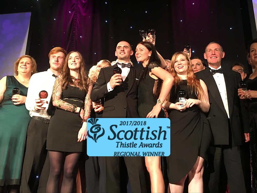 john receiving visit scotland thistle award.jpg