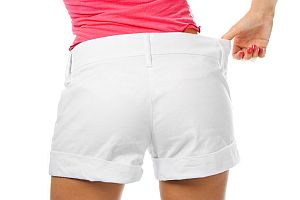 thin waist woman in big shorts