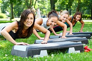 young and attractive people doing fitness exercises