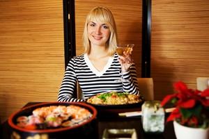 Beutiful blond girl in japanese restaurant