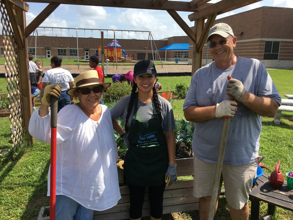 Rose Ann Costa, Karen Santos and Randal Bell lend a hand at Quail Valley Elementary School's Garden end of year harvest.