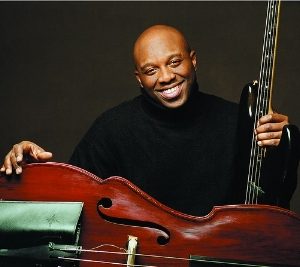 - Charnett Moffett peformed for REJS March, 31 2017.Mr Moffett is an American jazz musician[1] and composer known as an innovator and virtuoso who plays piccolo bass, double bass, and bass guitar.[2] He currently leads his band Nettwork.Moffett started playing bass in the family band, touring the Far East in 1975 at the age of eight. In the mid-198Charnett Moffett peformed for REJS March, 31 2017.Mr Moffett is an American jazz musician[1] and composer known as an innovator and virtuoso who plays piccolo bass, double bass, and bass guitar.[2] He currently leads his band Nettwork.Moffett started playing bass in the family band, touring the Far East in 1975 at the age of eight. In the mid-1980s he played with Wynton Marsalis and Branford Marsalis. In 1987 he recorded his debut album Netman for Blue Note Records. He has performed and recorded with Alex Bugnon, Art Blakey, Arturo Sandoval, Babatunde Lea, Courtney Pine, David Sanborn, David Sánchez, Dianne Reeves, Dizzy Gillespie, Ellis Marsalis, Frank Lowe, Harry Connick, Jr., Herbie Hancock, Jana Herzen, Joe Henderson, Kenny Garrett, Kenny Kirkland, Kevin Eubanks, Lew Soloff, Manhattan Jazz Quintet, McCoy Tyner, Melody Gardot, Mulgrew Miller, Ornette Coleman, Pharoah Sanders, Sonny Sharrock, Stanley Jordan, and Wallace Roney.Charnett Moffett attended Fiorello H. LaGuardia High School of Music & Art and Performing Arts in New York City and later studied at Mannes College of Music and the Juilliard School of Music. In 1983, he played on saxophonist Branford Marsalis' debut as a leader, Scenes in the City, and the following year he joined trumpeter Wynton Marsalis' quintet, appearing on 1985's acclaimed Black Codes (From the Underground). During the 1980s, Moffett also worked with Stanley Jordan, appearing on the innovative guitarist's best-selling 1985 Blue Note debut, Magic Touch, as well as two Blue Note albums with drummer Tony Williams' quintet: 1987's Civilization and 1988's Angel Street. In 1987, Moffett signed with Blue Note Records and debuted as a leader that year with his first of three albums for Blue Note, Beauty Within, which featured his father Charles Moffett on drums, older brothers Codaryl Moffett on drums and Mondre Moffett on trumpet, Kenny Garrett on alto saxophone, and Stanley Jordan on guitar.0s he played with Wynton Marsalis and Branford Marsalis. In 1987 he recorded his debut album Netman for Blue Note Records. He has performed and recorded with Alex Bugnon, Art Blakey, Arturo Sandoval, Babatunde Lea, Courtney Pine, David Sanborn, David Sánchez, Dianne Reeves, Dizzy Gillespie, Ellis Marsalis, Frank Lowe, Harry Connick, Jr., Herbie Hancock, Jana Herzen, Joe Henderson, Kenny Garrett, Kenny Kirkland, Kevin Eubanks, Lew Soloff, Manhattan Jazz Quintet, McCoy Tyner, Melody Gardot, Mulgrew Miller, Ornette Coleman, Pharoah Sanders, Sonny Sharrock, Stanley Jordan, and Wallace Roney.Charnett Moffett attended Fiorello H. LaGuardia High School of Music & Art and Performing Arts in New York City and later studied at Mannes College of Music and the Juilliard School of Music. In 1983, he played on saxophonist Branford Marsalis' debut as a leader, Scenes in the City, and the following year he joined trumpeter Wynton Marsalis' quintet, appearing on 1985's acclaimed Black Codes (From the Underground). During the 1980s, Moffett also worked with Stanley Jordan, appearing on the innovative guitarist's best-selling 1985 Blue Note debut, Magic Touch, as well as two Blue Note albums with drummer Tony Williams' quintet: 1987's Civilization and 1988's Angel Street. In 1987, Moffett signed with Blue Note Records and debuted as a leader that year with his first of three albums for Blue Note, Beauty Within, which featured his father Charles Moffett on drums, older brothers Codaryl Moffett on drums and Mondre Moffett on trumpet, Kenny Garrett on alto saxophone, and Stanley Jordan on guitar.