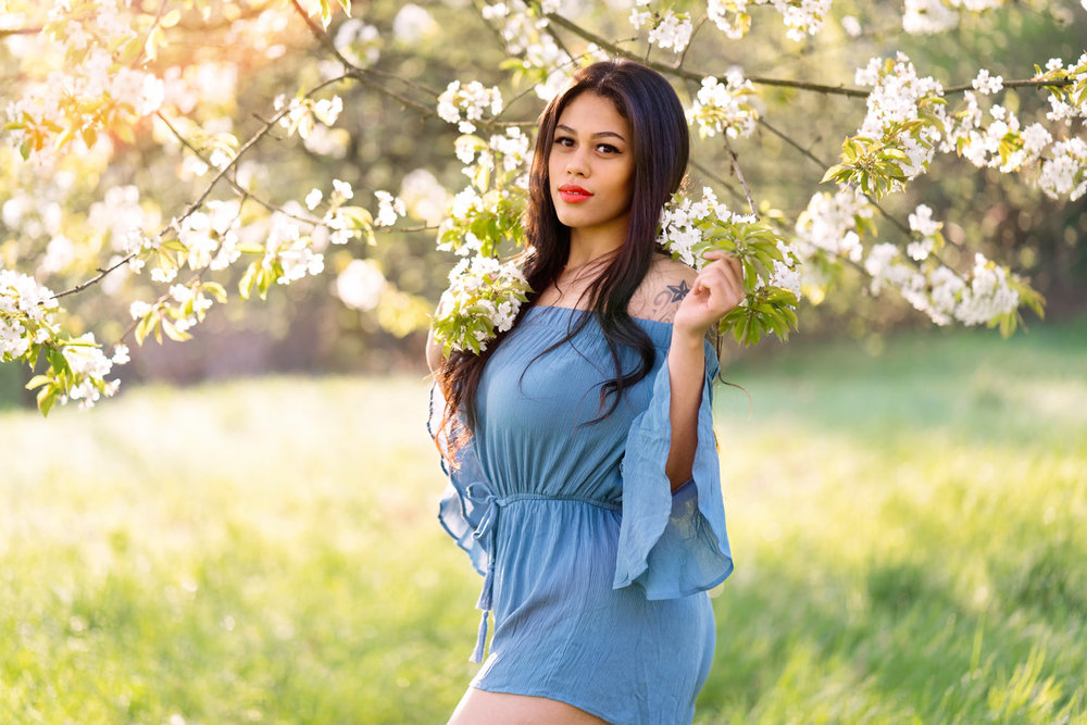 kaiserslautern Ramstein KMC Photographer beauty and portrait photography in Reichenbach-Steegen, Rheinland-Pfaly Germany. Beauty Portrait in Spring with beautiful dark hair girl in blue romper and white Cherry blossoms by Sarah Havens