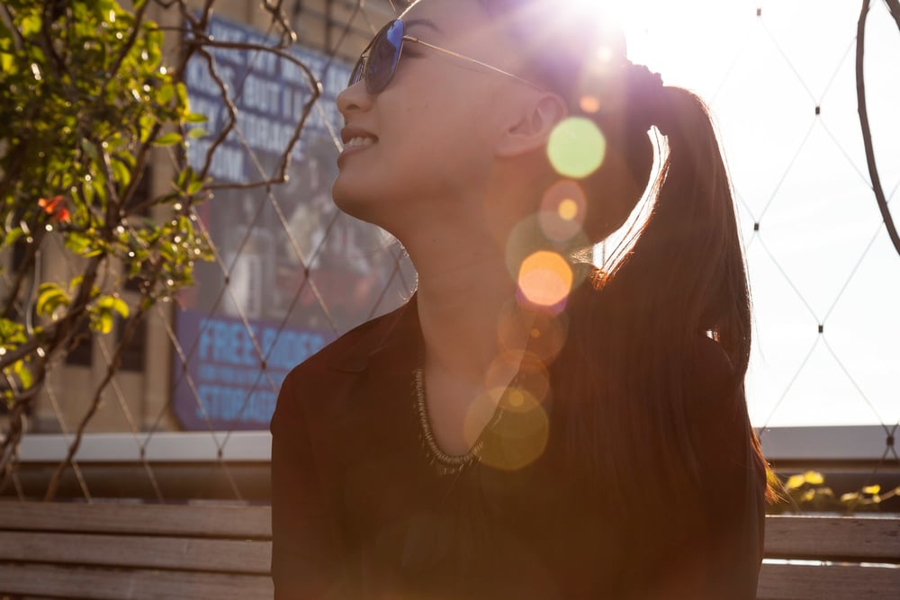 Sun rays, shades on.