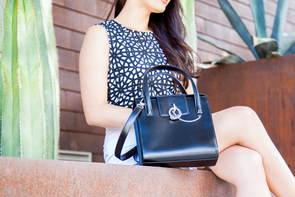 Geometric cutouts & structured Cartier bag