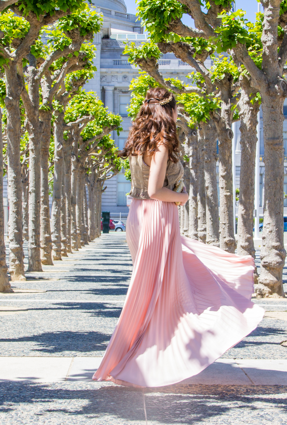 Twirling in a flowy pink maxi skirt | via The Chic Diary