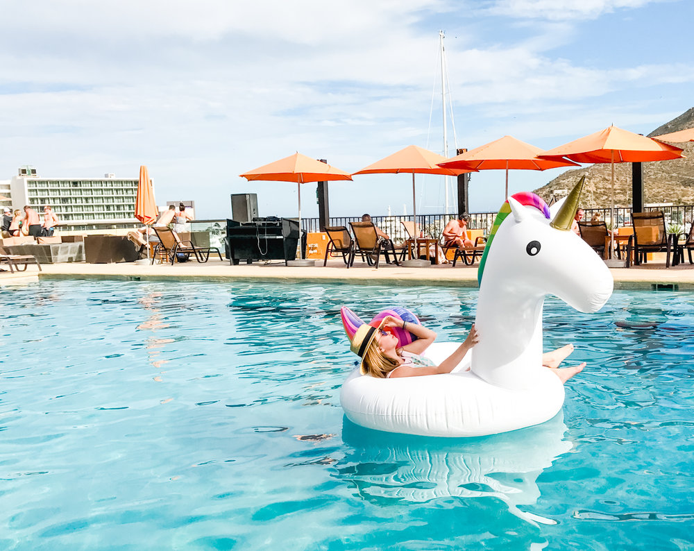 Relaxing on my unicorn pool float at Tesoro Los Cabos