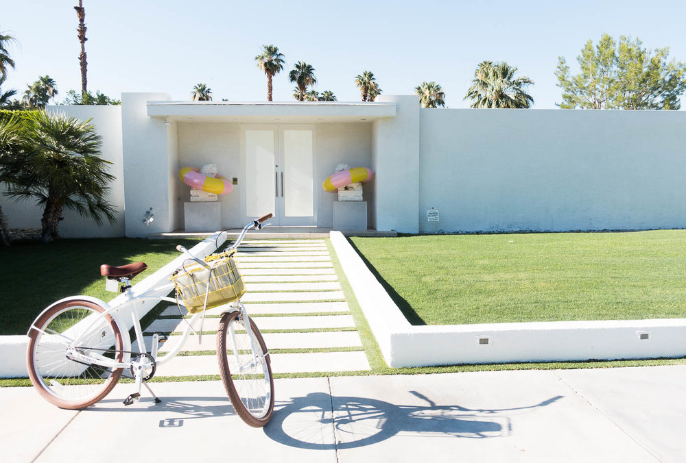 Palm Springs house with lion statues | The Chic Diary.jpg