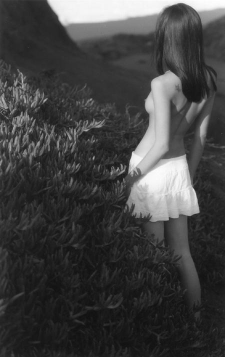 girlbybush.jpg