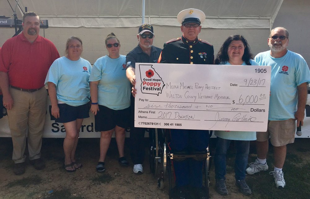 2017 Good Hope Poppy Festival  proudly presented  $7,000  (after all proceeds were counted) to:     Walton County Veterans Memorial     &     Moina Michael Poppy Project     :      All Terrain Chair Initiative