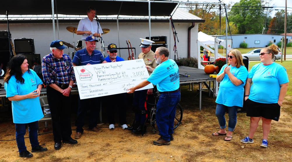 2015 Good Hope Poppy Festival  proudly presented  $5,000  (after all proceeds were counted) to:     Walton County Veterans Memorial     &     Moina Michael Poppy Project     :      All Terrain Chair Initiative