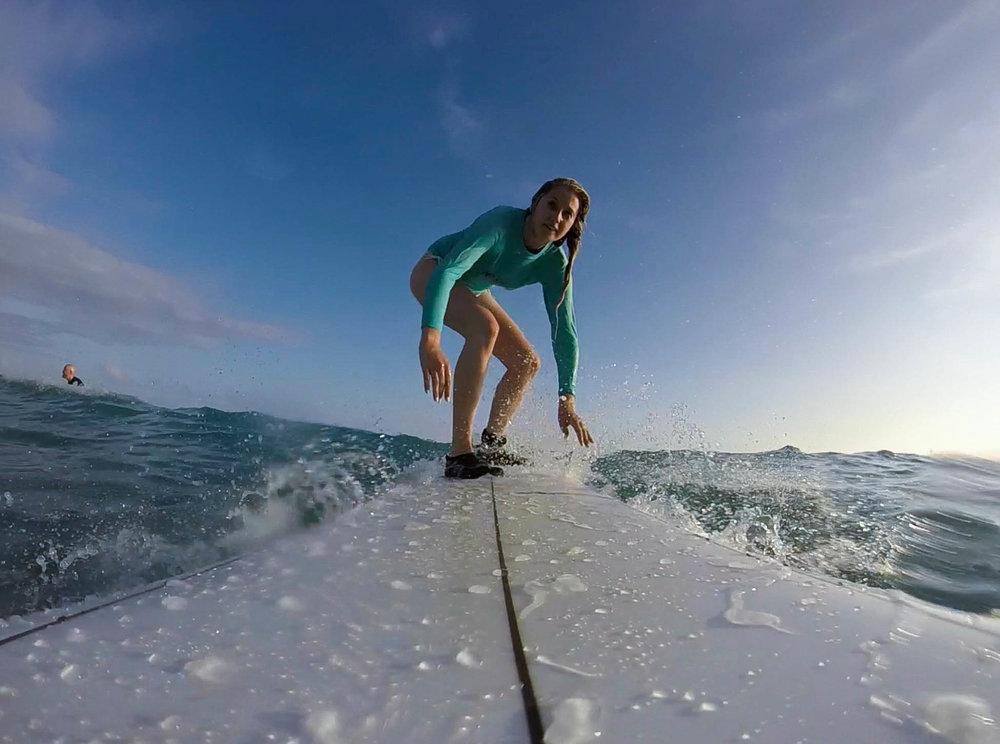 Surfing at Waikiki Beach - 13 Things To Do On Oahu | Kaci Nicole