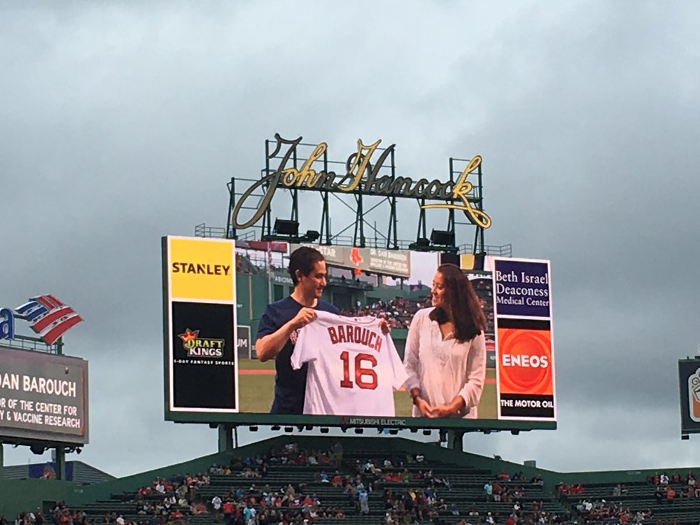 Dr. Barouch being given an honorary Red Sox jersey while being recognized as a Medical All-Star.