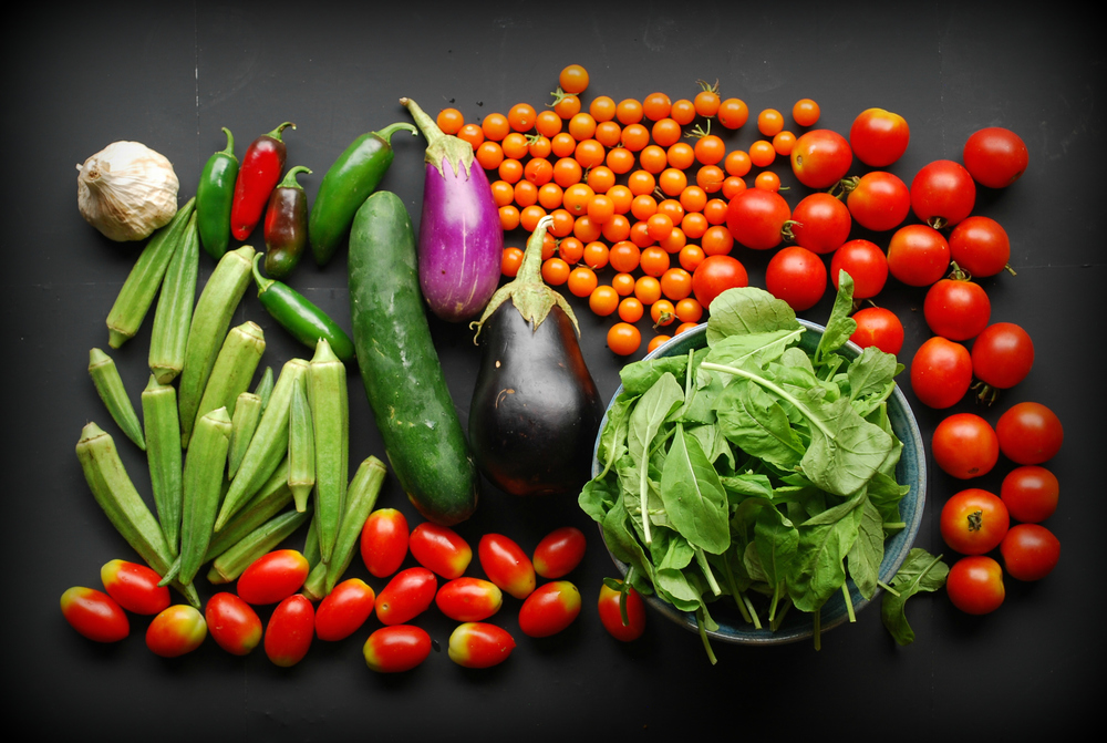 Your Week 18 share includes: garlic, okra, cucumber, eggplant, jalapeño peppers, Juliet tomatoes, Campari tomatoes, Sungold tomatoes, and arugula.