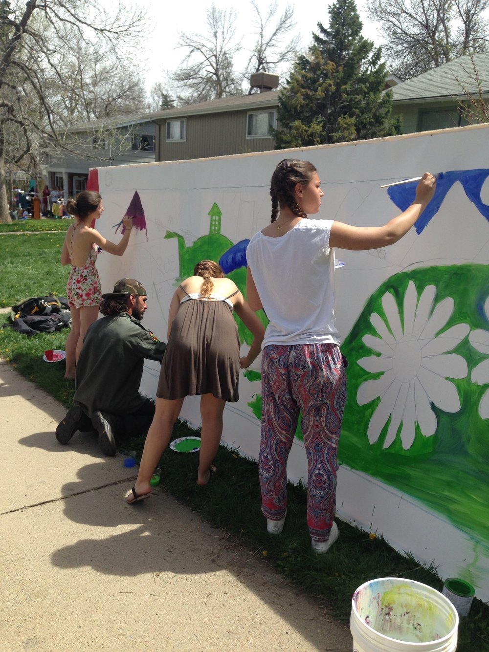 Mural painting during Fossil-Free Your Life North St. Block Party, Earth Day 2016