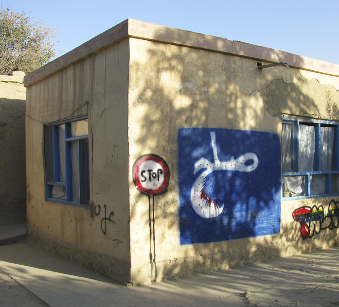 "[Graffiti representing ""peace"" in Dari on the old Gohar Khatoon girls'sSchool in Mazar-i-Sharif, Afghanistan]"