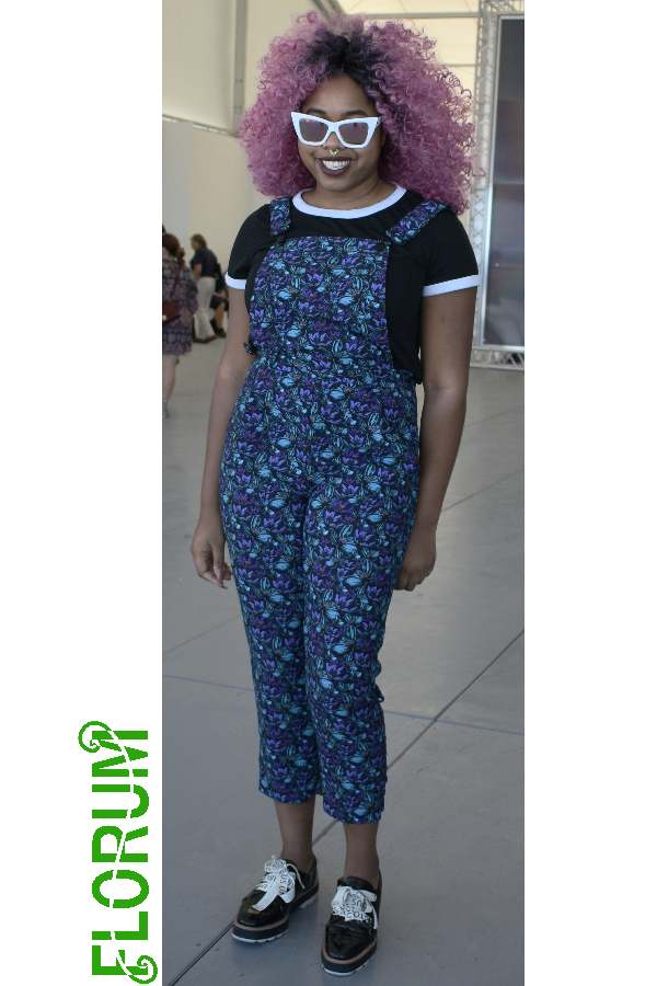 Colorful curls, printed overalls, fancy shades, & bold shoes spotted on Niani Tolbert