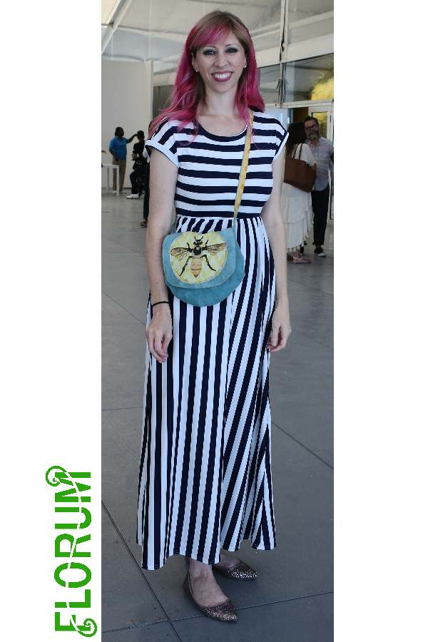 Colorful hair, stripes, and bumble bee cross body spotted on  Melanie Oliva
