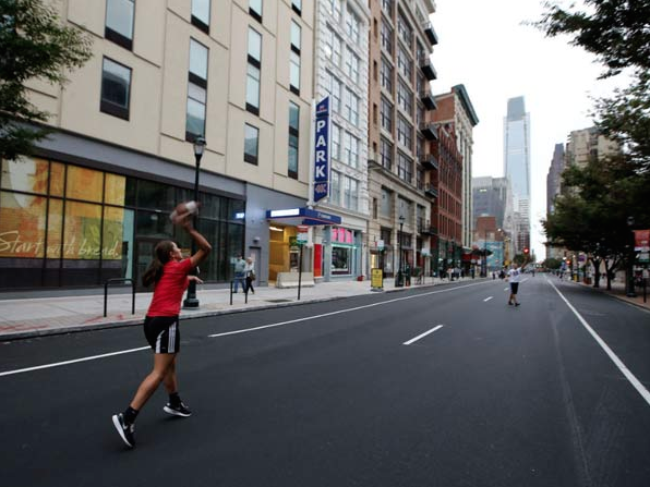 Kids play football along the 1200 block of Arch Street near the Pennsylvania Convention Center with no cars in their way on Friday, September 25, 2015. Photo: YONG KIM / Philly.com Staff Photographer