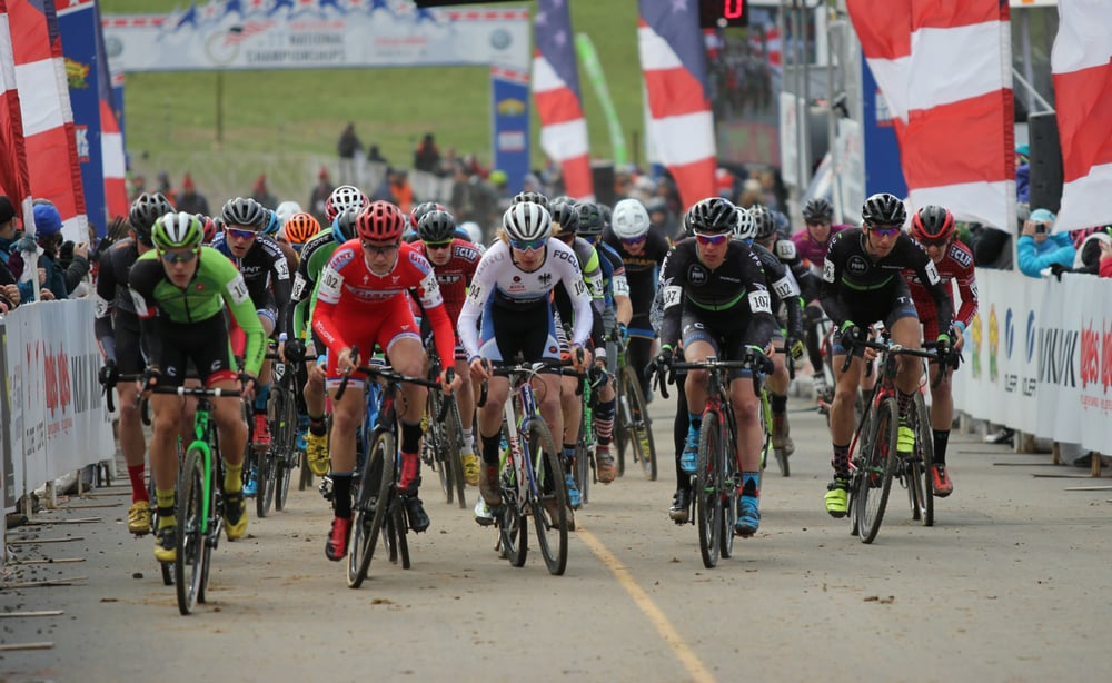 Scott Smith (center) charges off the start line with the U23 men's field at Cyclocross National Championships.