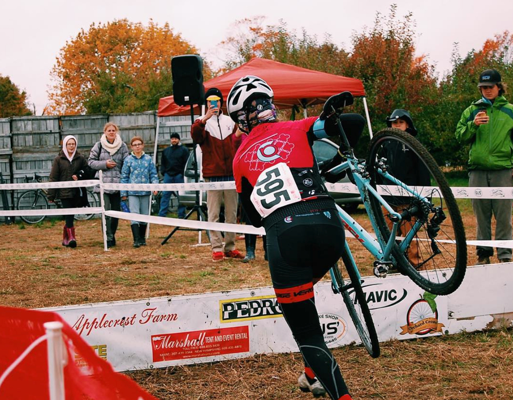 Katherine Johnson jumps the barriers on a borrowed bike at Orchard Cross on Oct. 25, 2015.