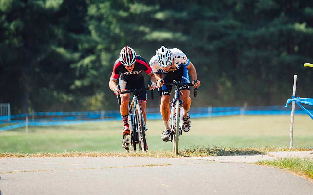 Chris Niesen (right) sprints for 5th place at Silk City Cyclocross on Saturday. Photo courtesy Team Health Warrior.