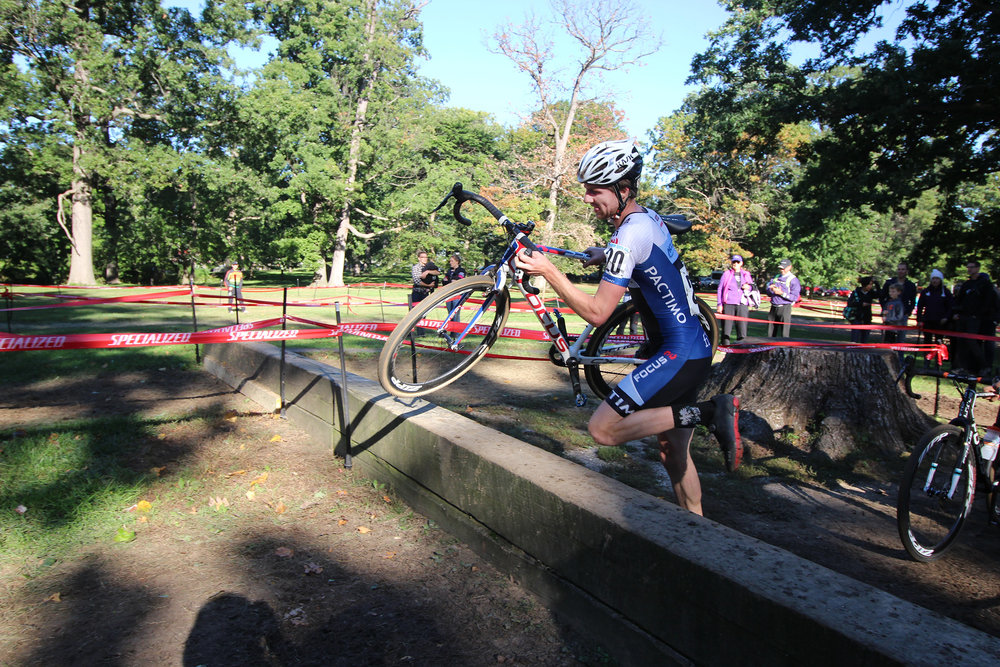 Jack Kisseberth jumps over the extra tall barriers on his way to 14th place at Charm City Cross on Sunday in Baltimore. Photo by Joie Chen.