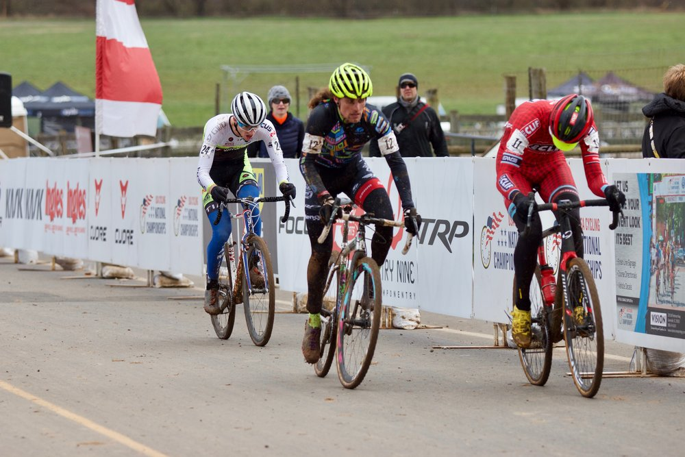 Jack Kisseberth on his last lap behind JAM Fund alum Anthony Clark (Squid Bikes) at the 2016 Cyclocross National Championships in Asheville, North Carolina. Kisseberth finished just outside of the top ten. Photo by Vicky Sama.