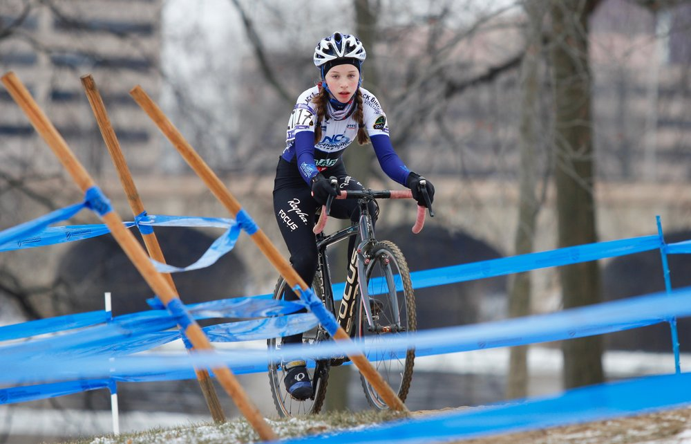 Mira Fowler rides the loops closest to the river during the Cyclocross National Championships in Hartford, Connecticut. Photo by Vicky Sama.