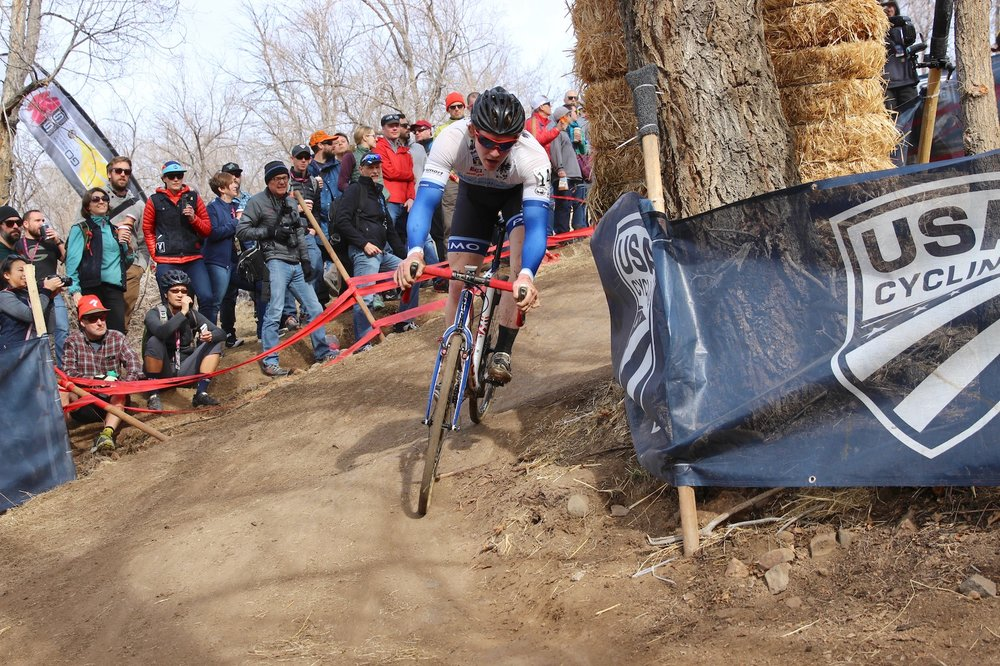 Kale Wenzcel smoothly navigates the sharp turn at the bottom of the descent during the men's U23. Photo by Vicky Sama.