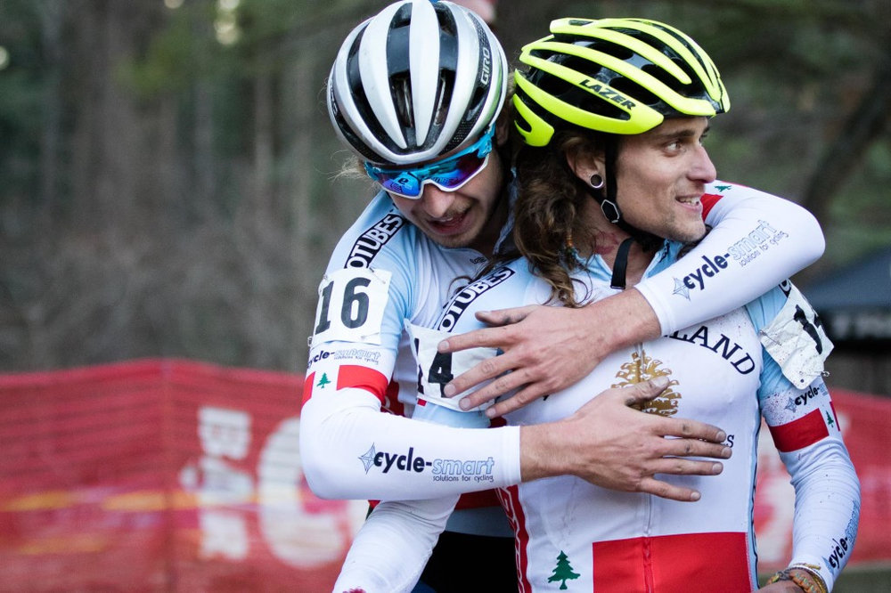 Scott Smith hugs former JAM teammate and friend Anthony Clark (Squid) after Clark wins day two and the overall series of the NBX Grand Prix on Dec. 6, 2015. Smith finished fifth overall and was the U23 race leader. Photo by John Kavouris.