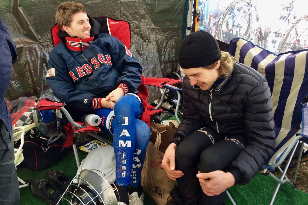 Kisseberth and Smith huddle near the space heater in the JAM Fund tent prior to the elite men's race at Cyclocross National Championships in Hartford, Connecticut on Jan. 8, 2017. Kisseberth finished 4th and Smith 13th. Photo by Vicky Sama.