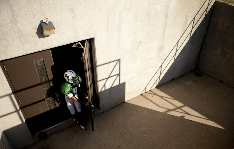 A football player exits the training room during practice Wednesday at Rock Bridge High School.