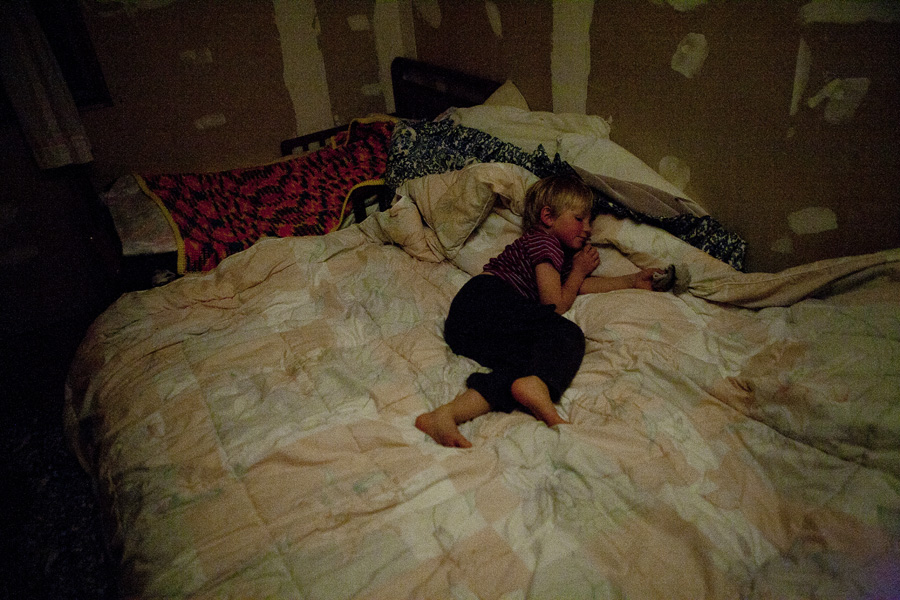 little boy sleeping in bed