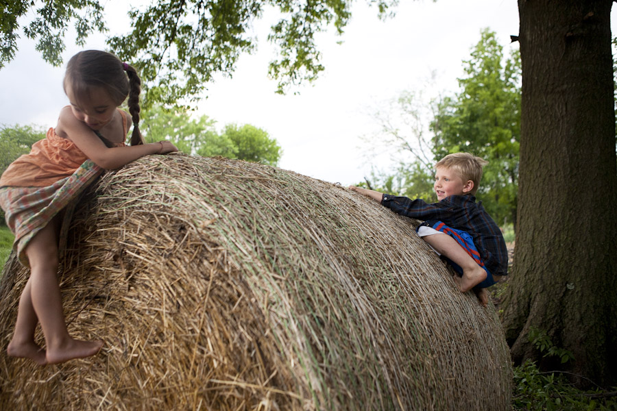 possibility alliance, rural missouri, playing on hay bales, kids playing, living off the grid, homestead
