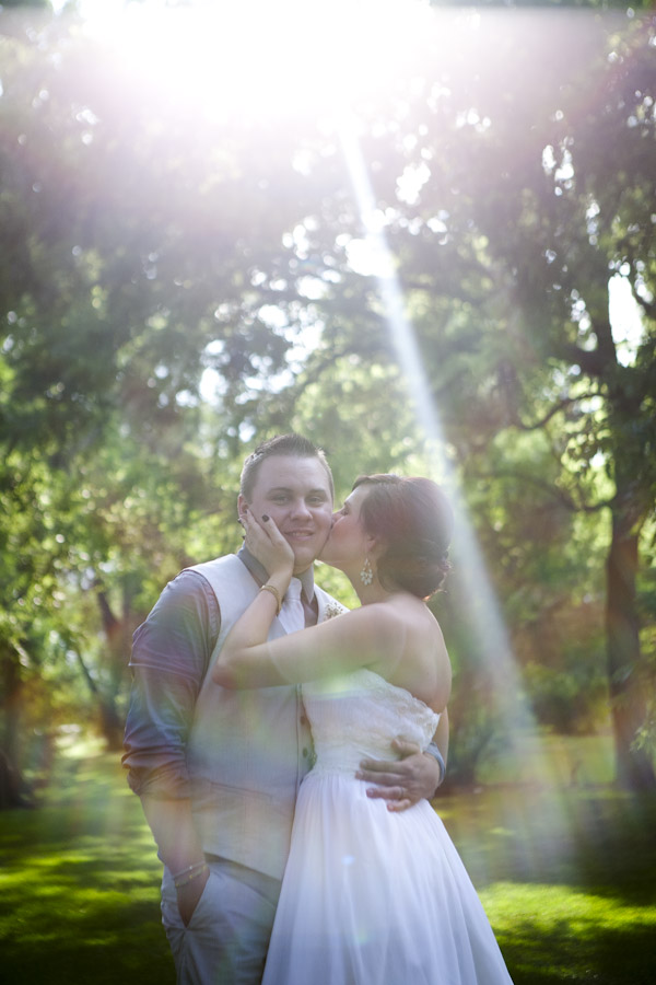 bride and groom lens flare