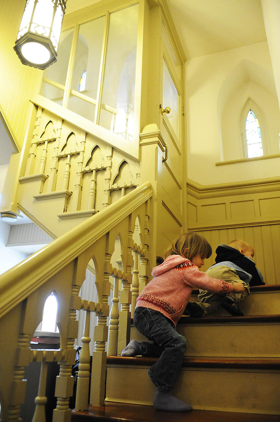Ava-Marie and brother Dominic Ridenour shuffle down the stairs during Ash Wednesday services on Wednesday, Feb. 13, 2013, at St. Francis Catholic Church in Staunton. The holy day marks the beginning of Lent, the 40-day period of observance that leads up to Easter.