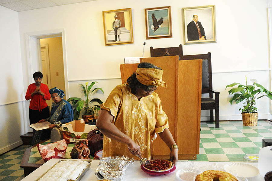 Anna L. Crawford, who helped organize the black history celebrations, slices pie during a soul food lunch at Ebenezer Baptist Church on Sunday, Feb. 24, 2013, in Staunton. The soul food spread included cornbread, baked beans, macaroni and cheese, fried chicken, corn, chitlins and pigs feet, plus an array of desserts.