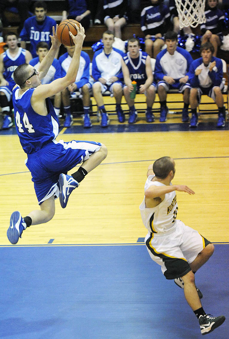 Fort Defiance's Ian Jarvis goes up for a shot as Northside's Parker Linden looks on during the Region III, Division 3 tournament semifinals on Wednesday, Feb. 20, 2013, at Spotswood High School.