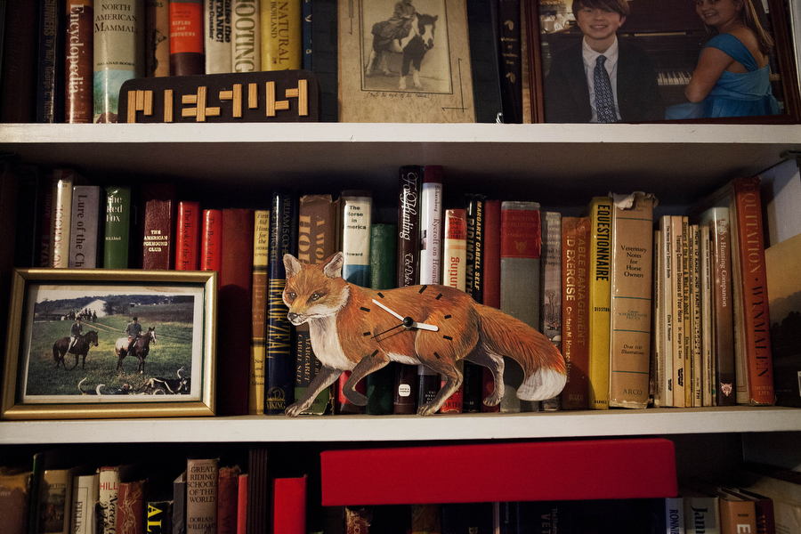 A fox clock and other fox-hunting knick knacks line the shelves at the home of Middlebrook Hunt Club Huntsman Fred Getty in Middlebrook. Getty has been fox hunting for decades and started out on Long Island before he relocated to Virginia with his hounds.