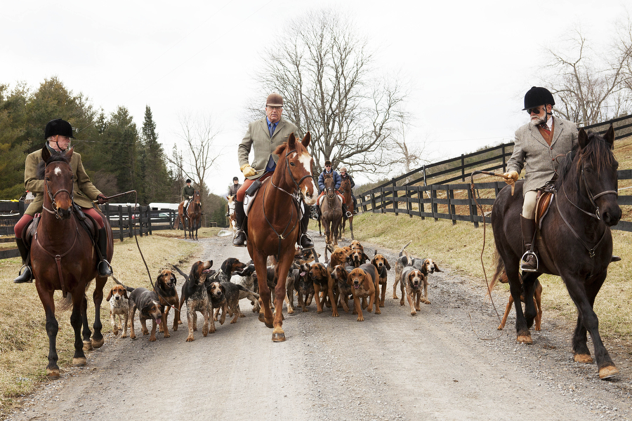 Alex Sproul, huntsman Fred Getty, John Patteson and the hounds set off on a foxhunt on Wednesday, March 13, 2013 in Middlebrook.