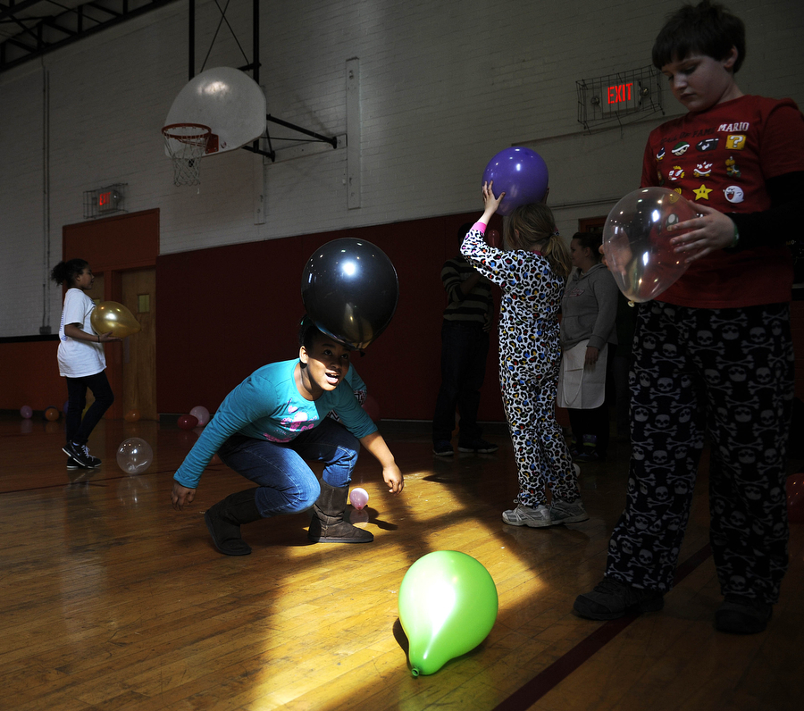 "Kids play with balloons during a ""last day party"" while at the Boys and Girls Club on Friday, March 15, 2013, at the Booker T. Washington Center."
