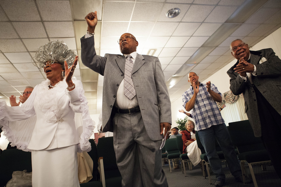 "Catherine ""Kitty"" Hamilton, husband Elder Al Hamilton and Wallace Reed stand up and dance during a performance during the Gospel Explosion at First Church of God in Church on Saturday, March 16, 2013, in Staunton. The event gathered various choirs, praise dancers and singers from area churches for a large gospel service."