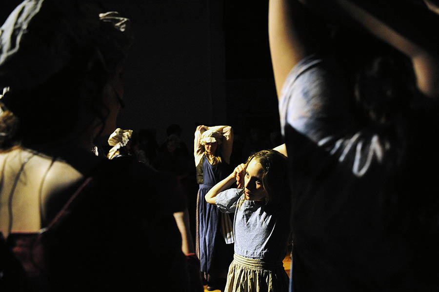 "Savannah McCarthy, who plays ""Young Cosette,"" (center) warms up with other cast members during dress rehearsal for ""Les Miserables"" on Tuesday, March 12, 2013 at Stuarts Draft High School. The play, which opens Thursday, features a cast of 65 people and 15 crew members."